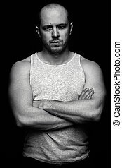 Macho - Vertical portrait of serious guy with crossed arms...