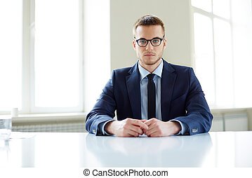 White collar worker - Portrait of an office worker sitting...