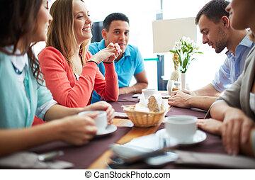 Coffee break - Portrait of happy teenage friends sitting in...