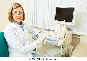 Doctor at workplace - Successful obstetrician sitting in her...