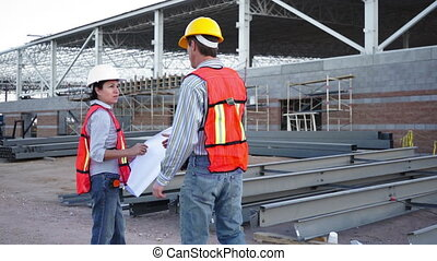 Industrial Male Enters Talks Schematic - Male worker dressed...