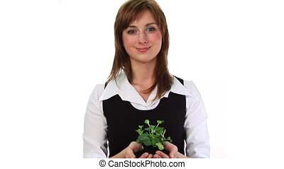 Woman holding a plant - HD footage of a woman holding a...