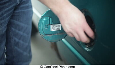 Filling up car gas tank with fuel at station
