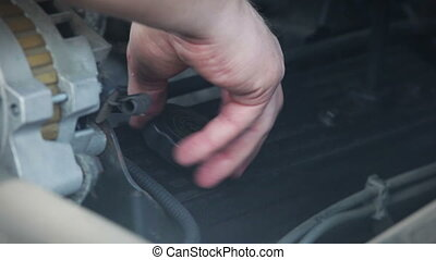 Checking oil under hood of car vehicle Adding oil