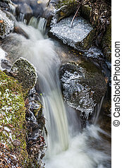 Small creek with a waterfall close up - Small waterfall with...