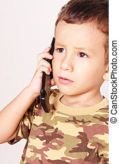 Child with black phone over white background...