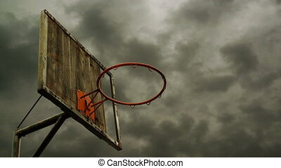Obsolete Basketball hoop with cage with clouds time lapse...