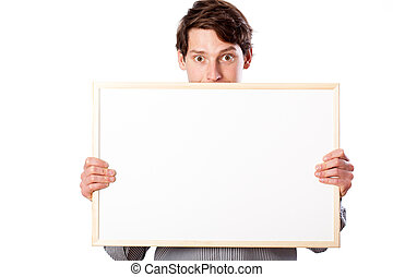 Happy man holding white blank board