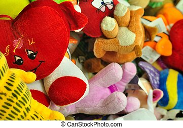 Colorful stuffed animal toys - Pile of colorful stuffed...