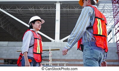 Industrial Male Enters Talks Low Angle - Male worker in...