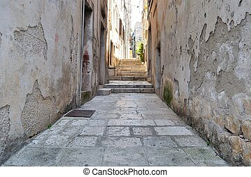 Narrow street in old medieval town.