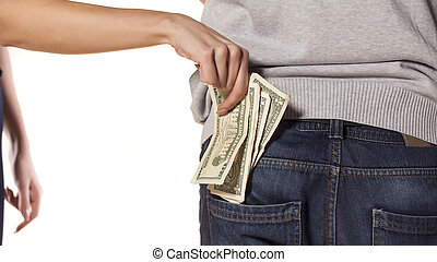 thief - woman pulls money out of the pocket of the man's...