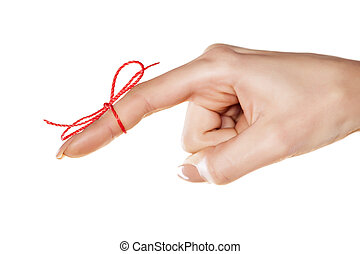 reminder - woman's finger bound with red thread