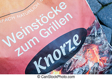 barbecue - bag with so called Knorzen, grapevines to fuel a...