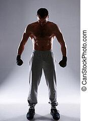 Full length portrait of a boxer preparing for training over...