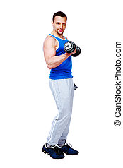 Full-length portrait of a muscular man working out with dumbbells on white background