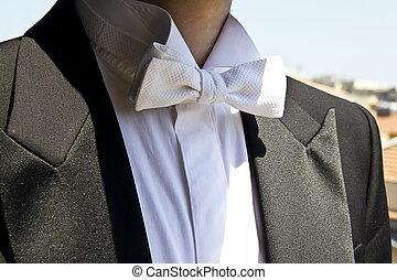 Papillon white, detail of frac, elegant men's wedding dress