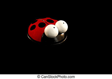 Lady bug - Close up of a lady bug toy on a black background