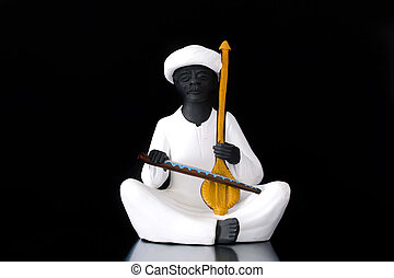 Lute player - Statue depicting a lute player on a black...