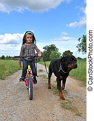 little girl and her dog - little girl with her purebred...