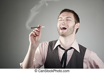 Laughing young man with small cigar - Portrait of laughing...