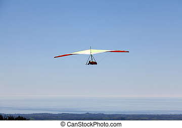 Hang glider flying over a mountain in Greece in a very...