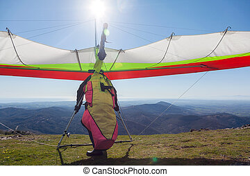 Hang glider launching off a mountain