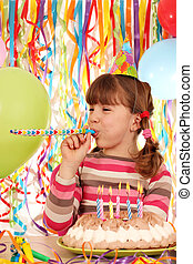 happy little girl with balloons and birthday cake