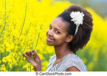 Outdoor portrait of a young beautiful african american woman...