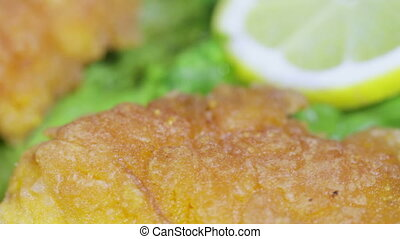 Fish roe on leaves of lettuce - On a rotating surface fried...