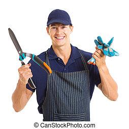 jardineiro, segurando, luvas, jardim, tesouras