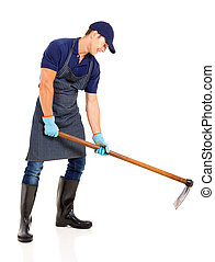 gardener working with a hoe isolated on white background