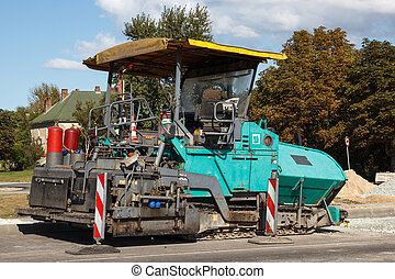 Asphalt paving machine - An asphalt paving machine at...