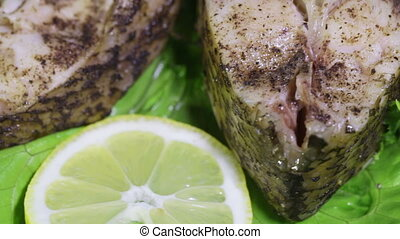 Bream on salad - On a rotating surface steamed bream