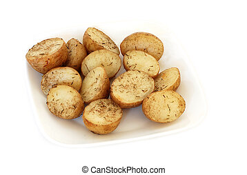 Roasted  potatoes with rosemary on a plate isolated on white
