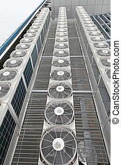 Central air conditioners condenser units at building rooftop