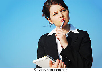 Businesswoman with notepad - A beautiful young business...