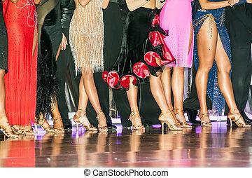 legs of woman weared in ballroom dress