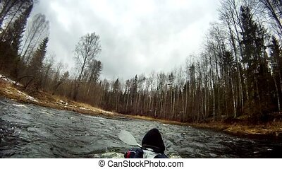 white-water rafting on a kayak - rafting on a kayak in the...