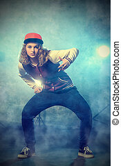 freestyle - Modern hip-hop dancer over grunge background