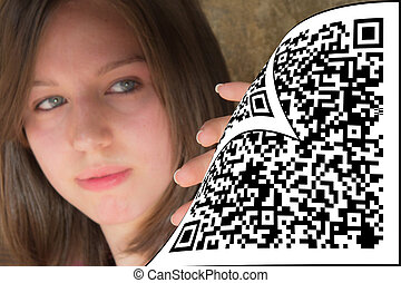 The woman who looks at what is behind the QR code