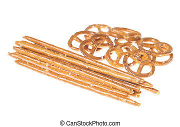 Nibbles - Salty sticks and pretzels isolated over a white...