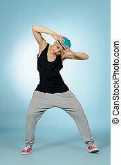 plasticity of movement - Modern girl dancer dancing in...