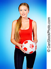 championship - Beautiful sporty woman posing with football....