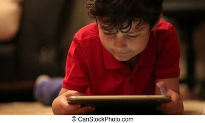 little kid using digital tablet 3