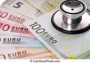 Health costs money - Euro banknotes and stethoscope