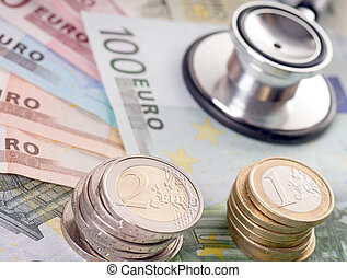 health costs money - Euro banknotes with euro coins and...