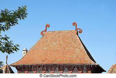 High Tiled Roof - high tiled roof with decorations over blue...