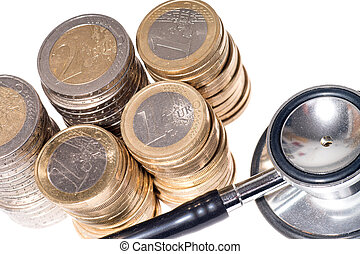 health service - Stethoscope with Euro coins over a white...