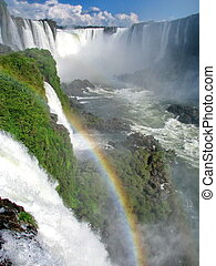 Brazil: Iguazu Waterfalls, with rainbow, seen from the...